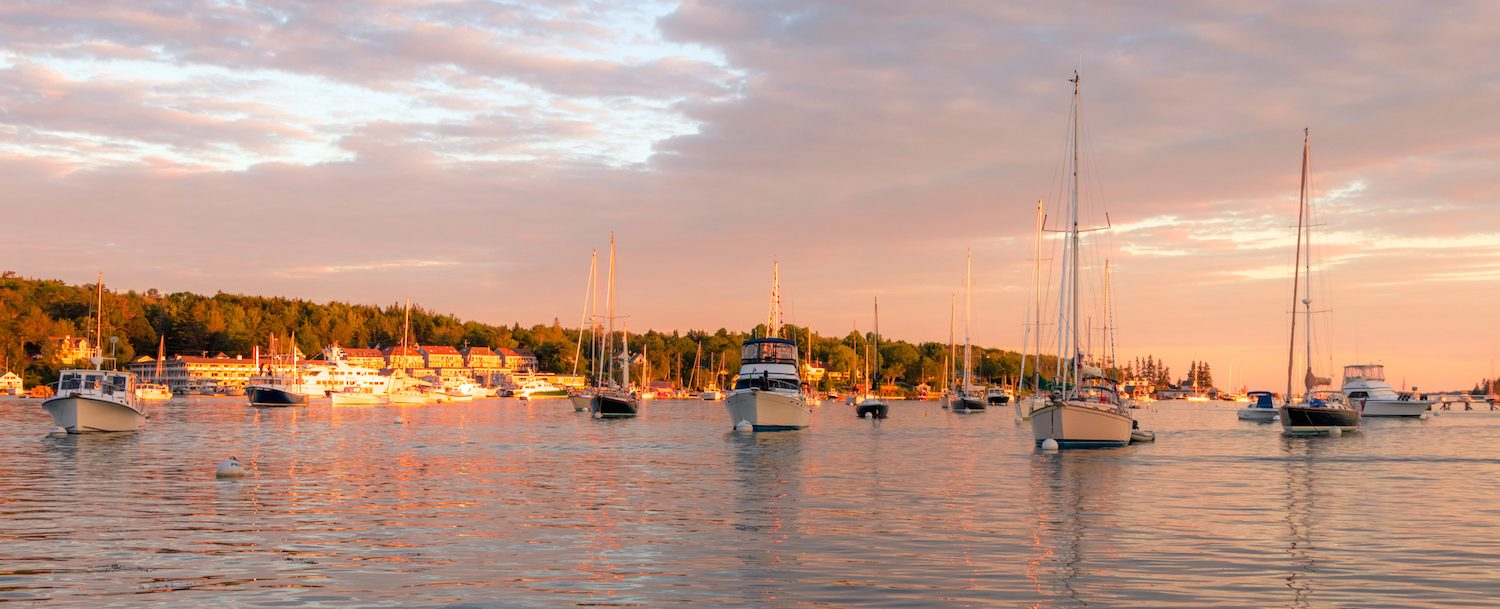 Boats in the calm and beautiful Boothbay Harbor in Maine at dusk