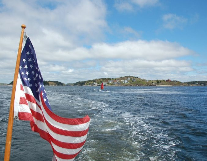 American Flag flying on a boat.